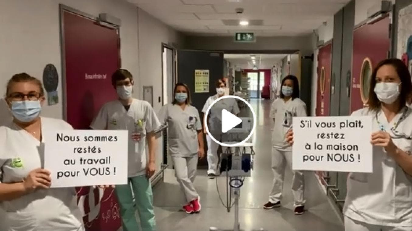 French doctors and nurse - STAY HOME message