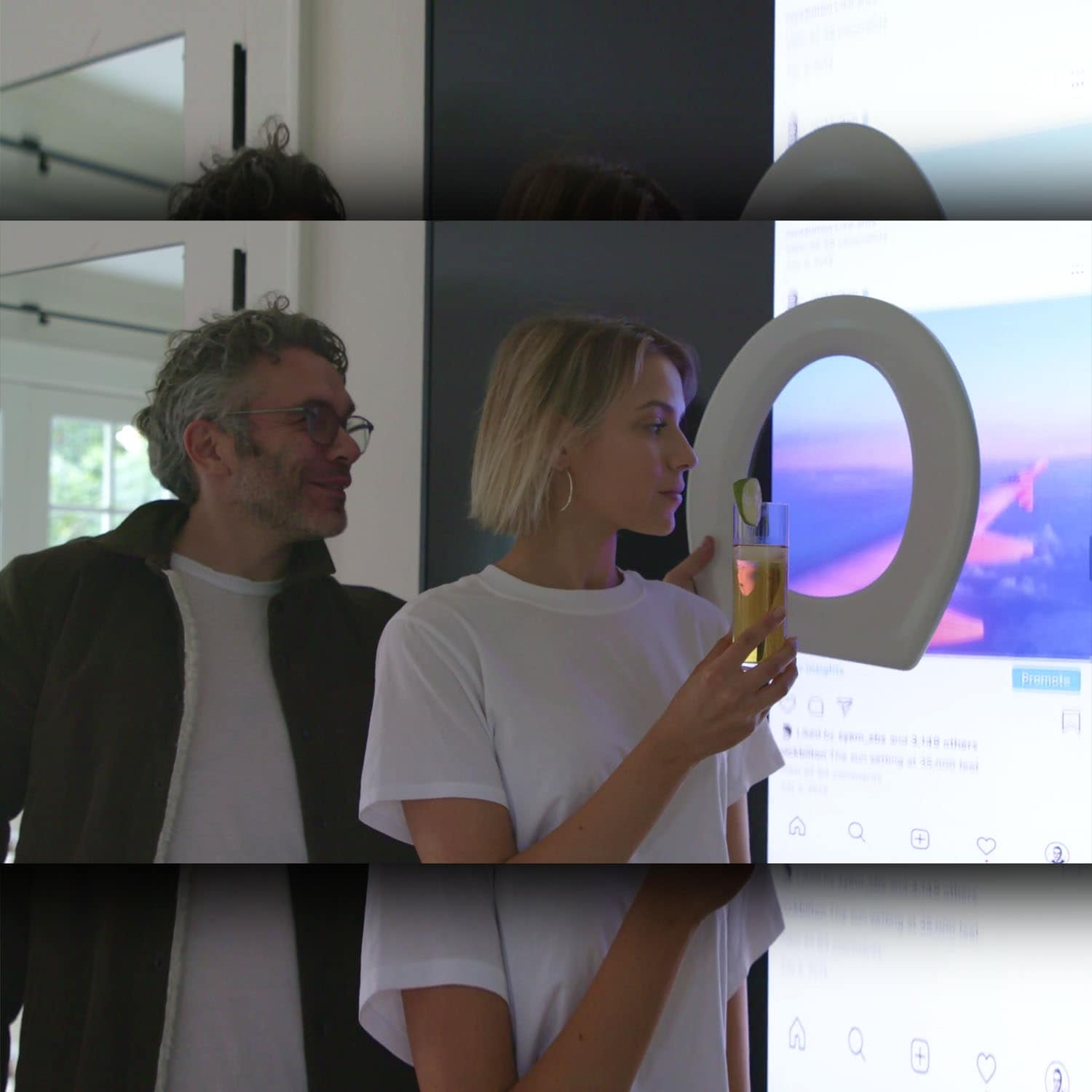 "Journalist Nick Bilton takes a photo of Dominique Druckman in the room faking private plain with photo on the screen and toilet seat for the HBO documentary ""Fake Famous."" Source: HBO"
