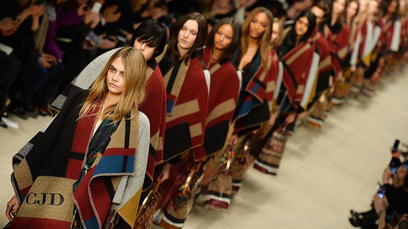 Models, led by Cara Delevingne (L) prese History of the Fashion Week